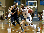 SIOUX FALLS, SD - MARCH 20: Daniel Carr #1 from Queens University drives to the basket past Jordan Heading #15 from Cal Baptist during their quarterfinal game at the 2018 Elite Eight Men's NCAA DII Basketball Championship at the Sanford Pentagon in Sioux Falls, SD. (Photo by Dave Eggen/Inertia)