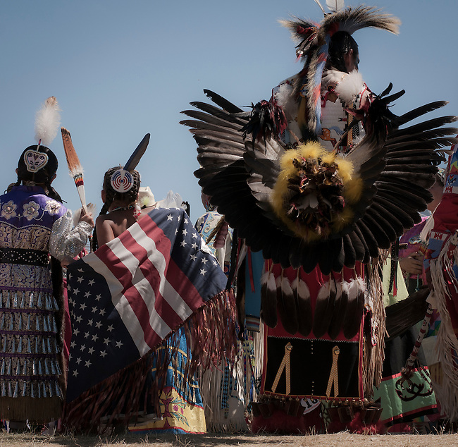 A young dancer shows her patriotism at the Julymish Pow Wow, Idaho.