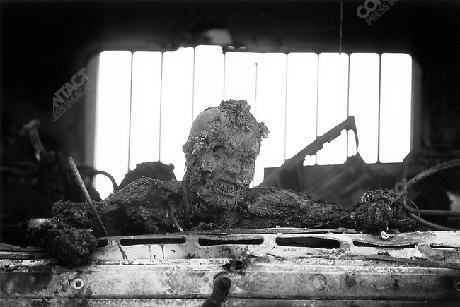 Iraqi casualty, from the final stages of Operation Desert Storm, First Gulf War. Nasiriyah, Iraq, March 1991