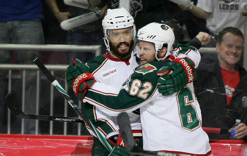 Houston Aeros' Jean-Michel Daoust, right, celebrates a second period goal with teammate Robbie Earl during game six of the AHL Calder Cup Finals against the Binghamton Senators, Tuesday, June 7, 2011, in Houston. Binghamton won 3-2 to take the championship. (Darren Abate/pressphotointl.com/AHL)