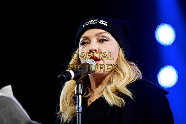 NEW YORK, NY - FEBRUARY 5: Madonna on stage during the Amnesty International: Bringing Home Human Rights Concert at the Barclay's Center on February 5, 2014  in New York City, NY., USA.<br /> CAP/MPI/RA<br /> &copy;Robert Altman/MediaPunch/Capital Pictures