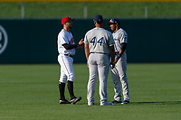 Indianapolis Indians Kevin Kramer (17) talks to Columbus Clippers Bobby Bradley (44) and Greg Allen (1) before an International League game against the Indianapolis Indians on April 29, 2019 at Victory Field in Indianapolis, Indiana. Indianapolis defeated Columbus 5-3. (Zachary Lucy/Four Seam Images)