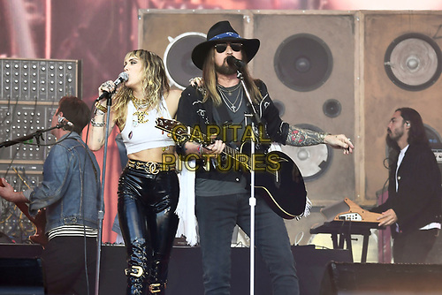 SHEPTON MALLET, ENGLAND - JUNE 30: Miley Cyrus and Billy Ray Cyrus performing at Glastonbury Festival, Worthy Farm, Pilton, on June 30, 2019 in Shepton Mallet, England.<br /> CAP/MAR<br /> ©MAR/Capital Pictures