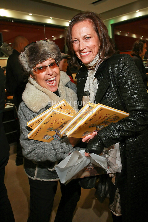 """Guests buy copies of """"A Life of Style"""" at the Rebecca Moses """"A Life of Style"""" book signing at Fratelli Rossetti Boutique, November 11, 2010."""