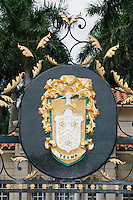 A Trump family crest hangs on the gate of the Trump International Golf Club in West Palm Beach, Florida.