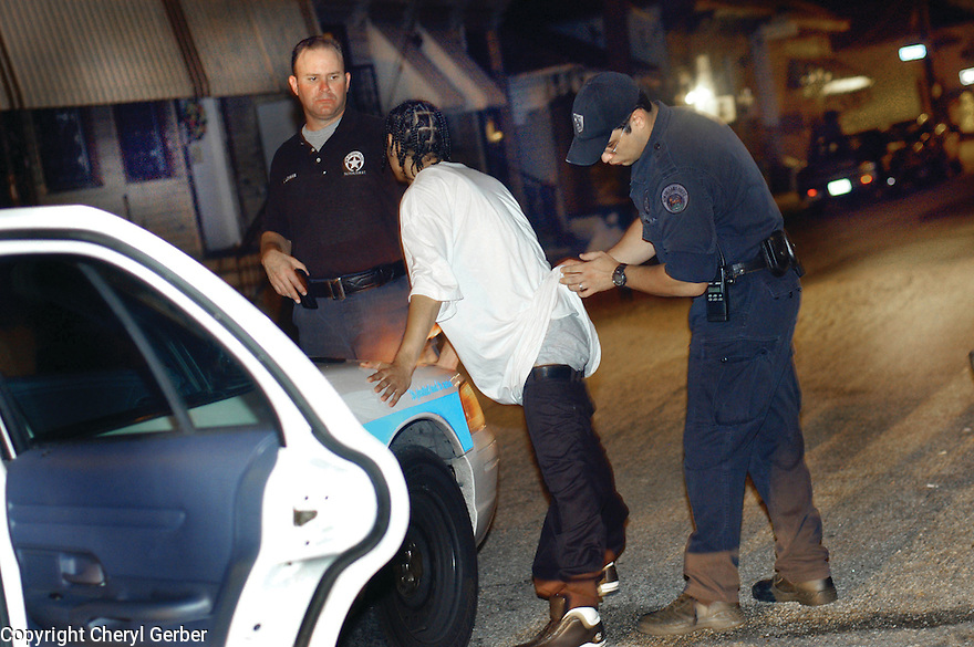 New Orleans police officers search a teen, 2004