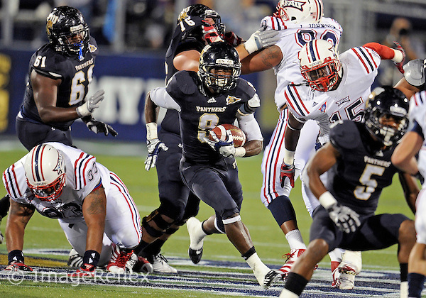 Florida International University football player running back Kedrick Rhodes (9) plays against the Florida Atlantic University on November 12, 2011 at Miami, Florida. FIU won the game 41-7. .