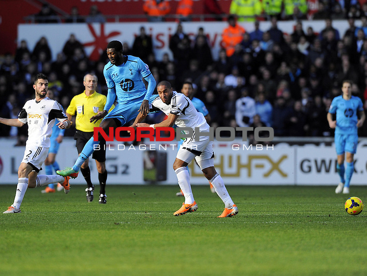 Tottenham Hotspur's Emmanuel Adebayor clashes with Swansea City's Ashley Williams -   19/01/2014 - SPORT - FOOTBALL - Liberty Stadium - Swansea - Swansea City v Tottenham Hotspur - Barclays Premier League<br /> Foto nph / Meredith<br /> <br /> ***** OUT OF UK *****