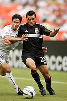The MetroStars' Joselito Vaca and D.C. United's Dema Kovalenko battle for the ball during first half action. D.C. United defeated the NY/NJ MetroStars 6 to 2 at RFK Stadium, Washington, D.C., on July 3, 2004.