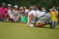 Ross Fisher's (ENG) caddie gets low to help an eagle attempt on 2 during 4th round of the World Golf Championships - Bridgestone Invitational, at the Firestone Country Club, Akron, Ohio. 8/5/2018.<br /> Picture: Golffile | Ken Murray<br /> <br /> <br /> All photo usage must carry mandatory copyright credit (© Golffile | Ken Murray)