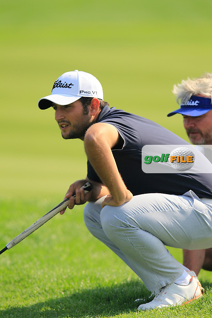 Alexander Levy (FRA) and caddy Bo line up his putt on the 8th green during Sunday's Final Round of the 2014 BMW Masters held at Lake Malaren, Shanghai, China. 2nd November 2014.<br /> Picture: Eoin Clarke www.golffile.ie