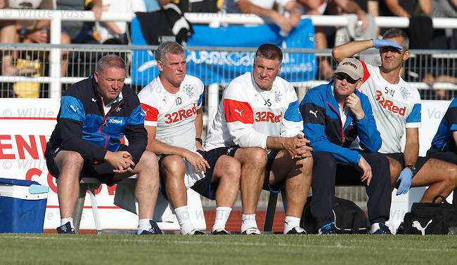 Ally McCoist watches on from the bench