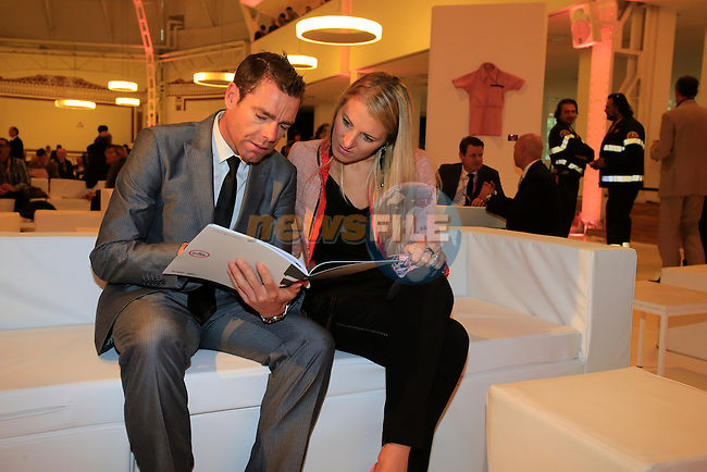 Cadel Evans (AUS) and Chiara Passerini study next year's road book at the 2014 Giro d'Italia Presentation held in the Palazzo del Ghiaccio in Milan, Italy. 7th October 2013.<br /> (Photo: Eoin Clarke/www.newsfile.ie)