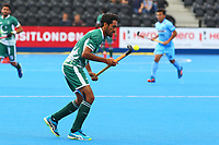 Pakistan's Tasawar Abbas controls the ball during the Hockey World League Semi-Final 5-8th place match between Pakistan and India at the Olympic Park, London, England on 24 June 2017. Photo by Steve McCarthy.