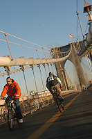 (051114-SWR002) New York, NY - 14 November 2005 -- Cyclists use a shared path across the Brooklyn Bridge .