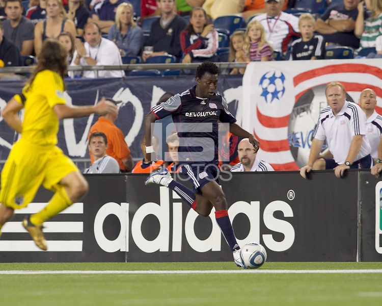 New England Revolution forward Kenny Mansally (7) dribbles down the wing. The New England Revolution tied Columbus Crew, 2-2, at Gillette Stadium on September 25, 2010.