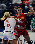 BELGRADE, SERBIA - DECEMBER 16:Andjela Bulatovic of Montenegro (R) is challenged by Heidi Loke (L) of Norway during the Women's European Handball Championship 2012 gold medal match between Norway and Montenegro at Arena Hall on December 16, 2012 in Belgrade, Serbia. (Photo by Srdjan Stevanovic/Getty Images)