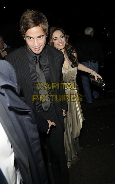 "DANNY CIPRIANI & KELLY BROOK.The ""Fat Pig"" press night afterparty, K Bar, Upper St. martin's lane, London, England..October 20th, 2008.after party full length black pinstripe suit gold beige dress couple silver sandals .CAP/CAN.©Can Nguyen/Capital Pictures."