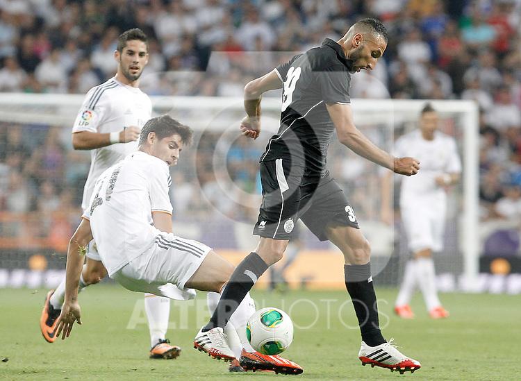 Real Madrid's Alvaro Morata (L) and Al Sadd's Nadir Balhadj during Santiago Bernabeu Trophy.August 22,2013. (ALTERPHOTOS/Acero)