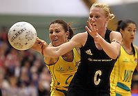 09.06.2011 Silver Ferns Laura Langman and Australian Diamonds Natalie Von Bertouch in action during the netball match between the Silver Ferns and Australia held at Arena Manuwau in Palmerston North. Mandatory Photo Credit ©Michael Bradley.