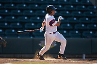Carlos Perez (14) of the Winston-Salem Rayados follows through on his swing against the Lynchburg Hillcats at BB&T Ballpark on June 23, 2019 in Winston-Salem, North Carolina. The Hillcats defeated the Rayados 12-9 in 11 innings. (Brian Westerholt/Four Seam Images)
