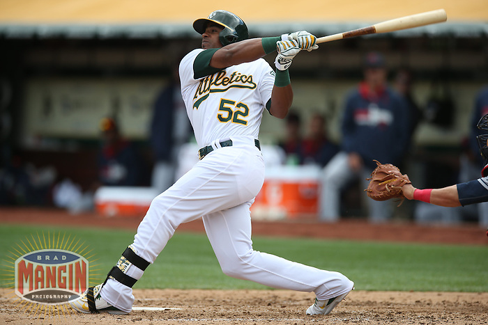OAKLAND, CA - APRIL 2:  Yoenis Cespedes #52 of the Oakland Athletics bats against the Cleveland Indians during the game at O.co Coliseum on Wednesday, April 2, 2014 in Oakland, California. Photo by Brad Mangin