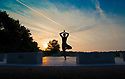 21/06/17<br /> <br /> A woman practices yoga as the sun rises on the longest day of the year at the StarDisc amphitheatre above Wirksworth, in the Derbyshire Dales.<br /> <br /> All Rights Reserved F Stop Press Ltd. (0)1773 550665 www.fstoppress.com