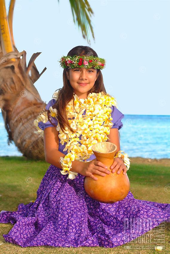 Keiki hula dancer with ipu at the beach.