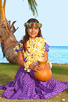 Keiki hula dancer with ipu at the beach.