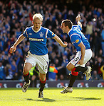 Steven Naismith scores his second and Rangers' fourth goal of the Old Firm match and celebrates with a happy David Healy