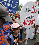 Detail view of people participating in the People's Climate March in New York City on Sunday, September 21, 2014. Photo by Jim Peppler. Copyright Jim Peppler 2014. All rights reserved.
