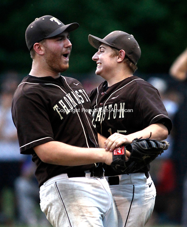 Berlin, CT- 10 June 2014-061014CM09-  Thomaston's  Brian Sousa, left, and Jake Torrence celebrate during their Class S state semi-final game against Cromwell Tuesday night.  Thomaston won, 5-4 advancing to the Class S state championship game.  Christopher Massa Republican-American
