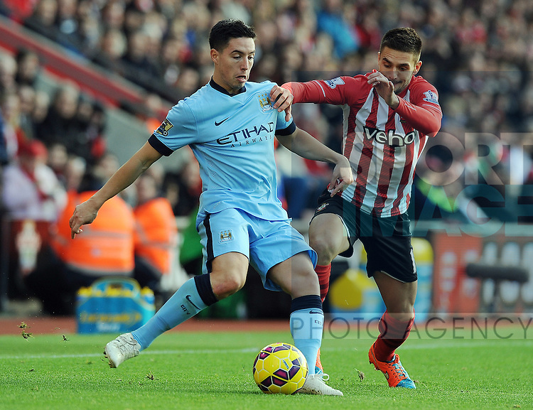 Samir Nasri of Manchester City is challenged by Dusan Tadic of Southampton<br /> - Barclays Premier League - Southampton vs Manchester City - St Mary's Stadium - Southampton - England - 30th November 2014 - Pic Robin Parker/Sportimage