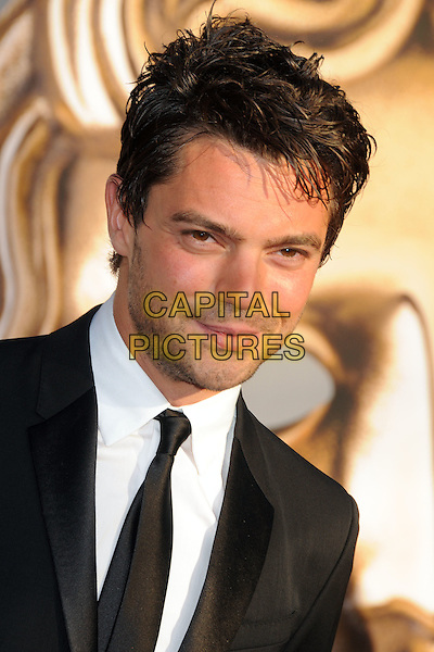 Dominic Cooper.BAFTA Brits to Watch Event held at the Belasco Theatre, Los Angeles, California, USA, 9th July 2011..portrait headshot white black shirt  beard facial hair  tie.CAP/ADM/BP.©Byron Purvis/AdMedia/Capital Pictures.