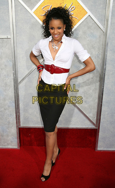 "CIARA.Los Angeles Premiere of ""Step Up"" at ArcLight Cinemas, Hollywood, California, USA..August 7th, 2006.Photo: Byron Purvis/AdMedia/Capital Pictures.Ref: ADM/BP.full length white top hands on hips black skirt red belt.www.capitalpictures.com.sales@capitalpictures.com.©Byron Purvis/AdMedia/Capital Pictures."