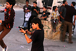 Palestinian boys play with toy guns to celebrate Eid al-Fitr during the second day of the holiday of Eid al-Fitr marking the end of Islam's fasting holy month of Ramadan, in the west Bank city of Ramallah on Aug. 09, 2013. Muslims around the world are celebrating Eid al-Fitr this week, marking the end of holiest month of Ramadan during which followers are required to abstain from food, drink and sex from dawn to dusk. Photo by Issam Rimawi
