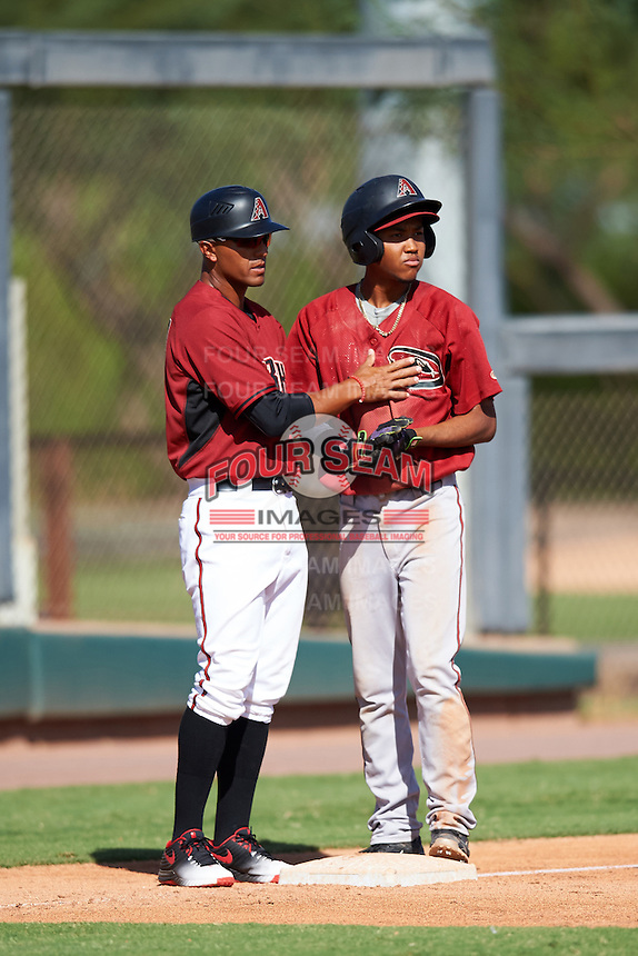 Arizona Diamondbacks coach Javier Colina (left) talks with Jose King (4) during an Instructional League game against the Colorado Rockies on October 7, 2016 at Salt River Fields at Talking Stick in Scottsdale, Arizona.  (Mike Janes/Four Seam Images)