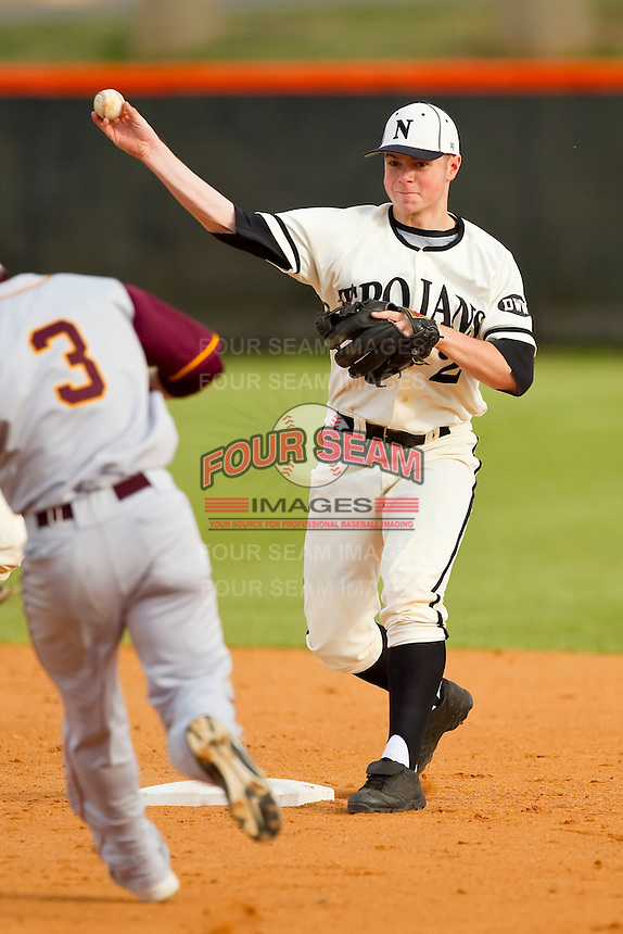 Northwest Cabarrus Trojans second baseman Tanner Bigham #2 turns a double play against the Sun Valley Spartans on March 7, 2012 in Kannapolis, North Carolina.  (Brian Westerholt/Four Seam Images)