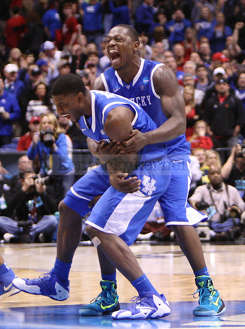 Alex Poythress and Julius Randle celebrate after UK defeated Louisville at the NCAA Sweet 16 vs. UofL at the Lucas Oil Stadium in Indianapolis, Ind., on Friday, March 28, 2014. Photo by Emily Wuetcher   Staff