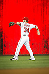 Washington Nationals outfielder Bryce Harper (34) warms up in the outfield prior to the start of an inning during a game against the Miami Marlins at Nationals Park in Washington, DC on September 7, 2012.