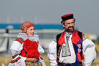 Czech catholic believers, wearing folk costume, wait for the arrival of the Pope Benedict XVI at the Prague Airport, Czech Republic, 26 September 2009.