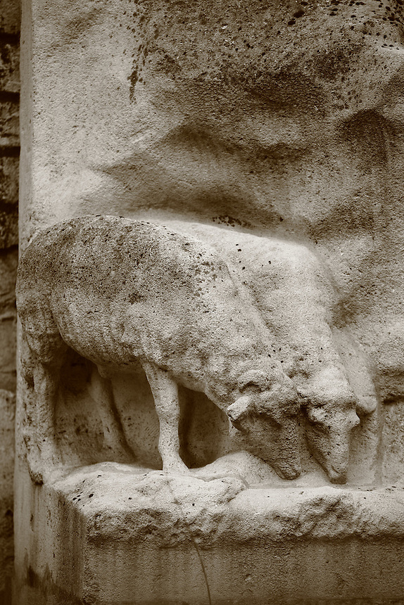 A part of the bas relief which decorates the exterior of the church of Saint Germain des Prés in Paris:  two sheep grazing grass (black & white). Digitally Improved Photo.