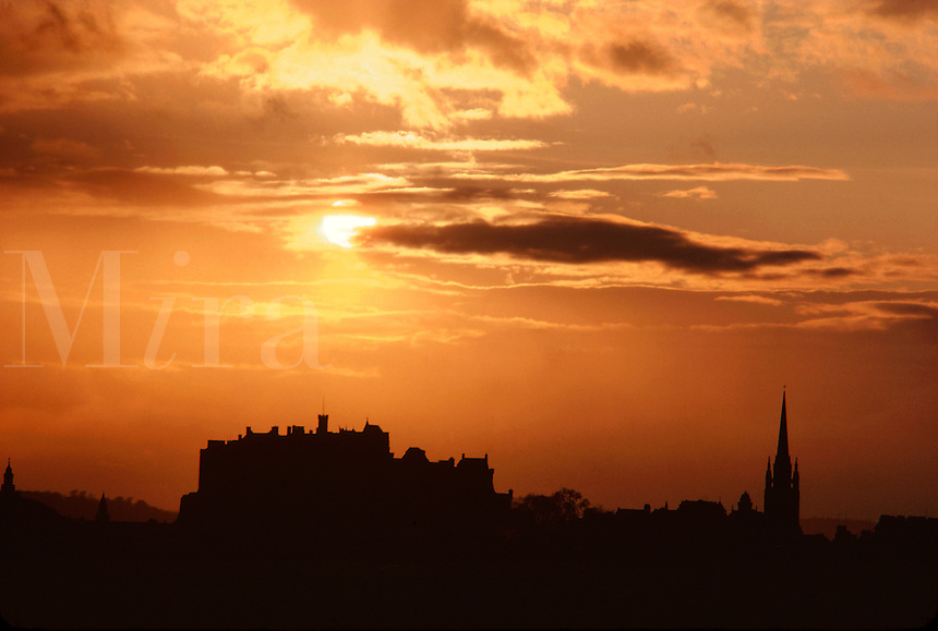 .The skyline of Edinburgh Castle seen against a sunset sky, Edinburgh, Scotland...