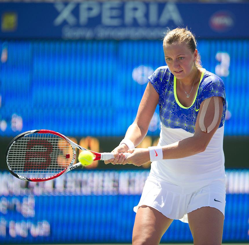 Petra Kvitova (CZE) in action during her victory over Shuai Peng (CHN) in their WTA Second Round Womens Singles match today - Petra Kvitova (CZE) d. Shuai Peng (CHN) 57 62 62..Tennis - Sony Open Tennis - ATP World Tour Masters 1000 - Tennis Center at Crandon Park Key Biscayne, Miami, Florida USA - Day 4 - Thursday 21st March 2013..© CameraSport - 43 Linden Ave. Countesthorpe. Leicester. England. LE8 5PG - Tel: +44 (0) 116 277 4147 - admin@camerasport.com - www.camerasport.com