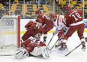 Chris Connolly (BU - 12) watches Nieto's shot go in. - The Boston University Terriers defeated the Harvard University Crimson 3-1 in the opening round of the 2012 Beanpot on Monday, February 6, 2012, at TD Garden in Boston, Massachusetts.