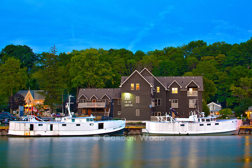 Fishing boats tied up alongside hotel on Lake Erie shoreline