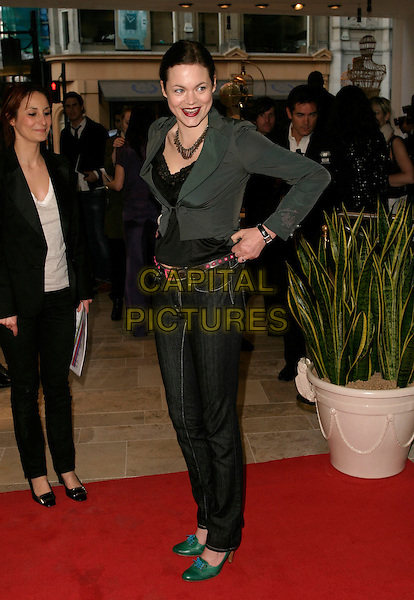 JASMINE GUINNESS.Diesel - store launch party, Diesel, 130 New Bond Street, London, UK..May 18th, 2006.Ref: AH.full length pulling up jeans denin grey gray jacket green shoes.www.capitalpictures.com.sales@capitalpictures.com.© Capital Pictures.