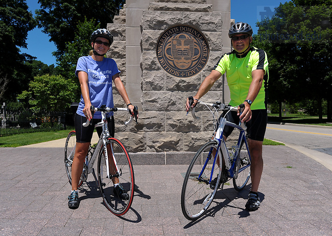 University of Notre Dame College of Science dean Greg Crawford, right, and his wife Renate pose with their bikes at the entrance to campus.  The Crawfords will bike from Tucson, AZ to Notre Dame in July and August of 2010 to raise awareness of Notre Dame's new partnership with the Ara Parseghian Medical Research Foundation...Photo by Matt Cashore/University of Notre Dame