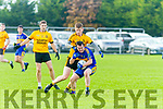 Darragh Behan St Senans under pressure from Joe Joe Grimes Listowel Emmets during the North Kerry Championship game played in Mountcoal on Sunday last.