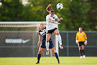 Portland Thorns forward Alex Morgan (13) heads the ball as Sky Blue FC defender Christie Rampone (3) looks on. Sky Blue FC and the Portland Thorns played to a 0-0 tie during a National Women's Soccer League (NWSL) match at Yurcak Field in Piscataway, NJ, on June 22, 2013.